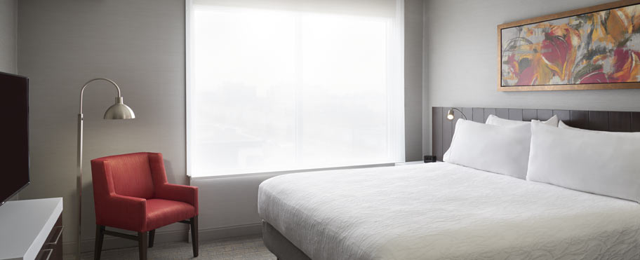 A spacious king suite with a large bed at the Hilton Garden Inn in Mississauga Toronto
