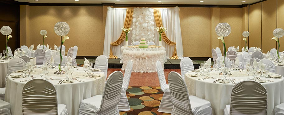 A beautiful ballroom decorated for a wedding in the Hilton Garden Inn in Mississauga Toronto